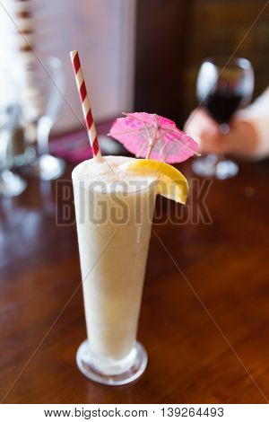 Pina Colada With Straw And Umbrella
