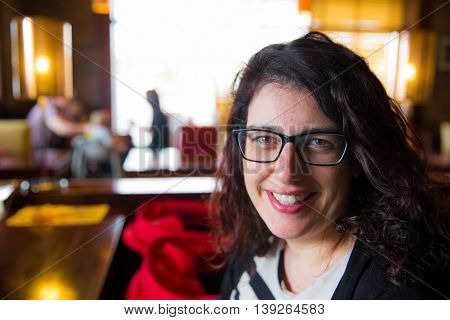 Smiling Young Mother In A Restaurant