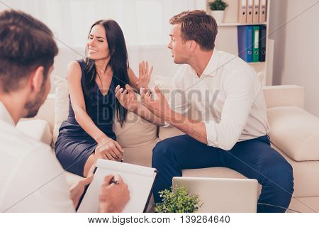 Stressed Young Family Quarrel At A Reception At The Psychologist