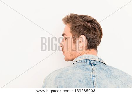 Back View Of Young Handsome Man On White Background