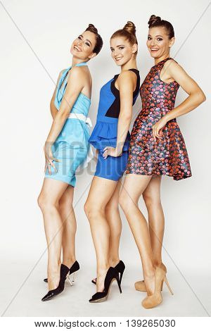 group of diverse stylish ladies in bright dresses isolated on white smiling having fun, watching selfie, posing cheerful, lifestyle concept