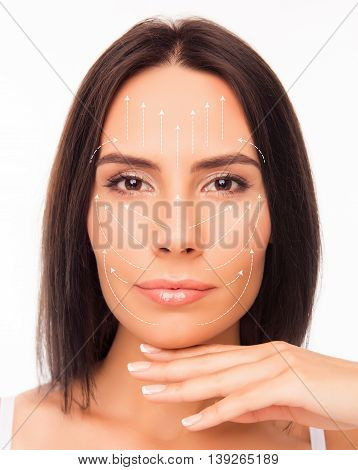 Close Up Photo Of Beautiful Young Woman Face With The Drawing Arrows On It.