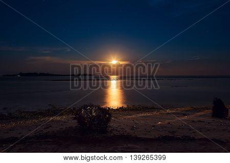 Romantic tropical beach with ocean beautiful full moon
