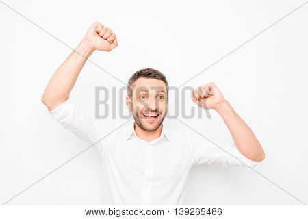 Happy Glad Man Celebrating Victory With Raised Hands