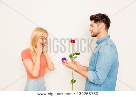 Young Man With Rose Making Marriage Proposal To His Girlfriend