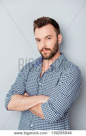 Portrait Of Handsome Young Minded Man With Crossed Hands