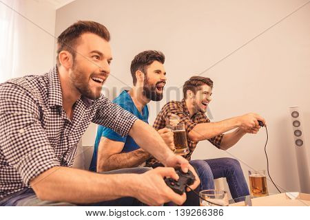 At Home Excited Happy Cheerful Men Play Video Game With Joystick