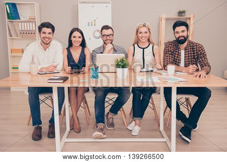 Photo Of  Happy Young  Group Of   Businesspeople Sitting At Conference Table Smiling