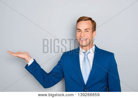 Cheerful Man In Blue Suit  Making Presentation Of New Product
