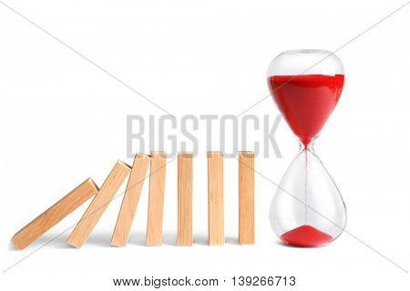 Wooden blocks and sand clock isolated on white