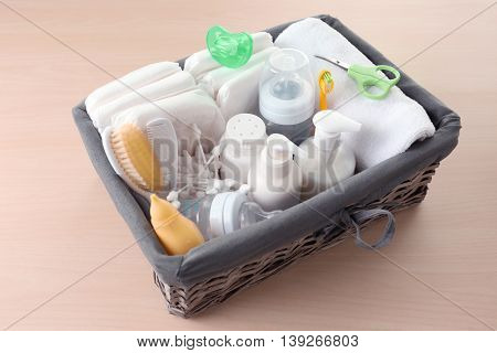 Wicker basket full of baby accessories for hygiene