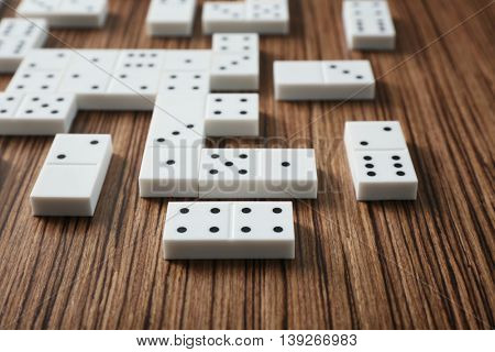 Heap of dominoes on wooden background