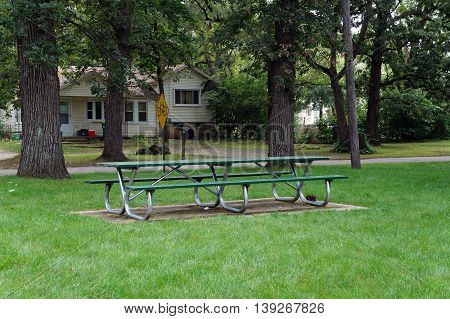 SHOREWOOD, ILLINOIS / UNITED STATES - AUGUST 30, 2015: Picnic benches are available for use in a public park along the shore of the Du Page River in Shorewood, Illinois.