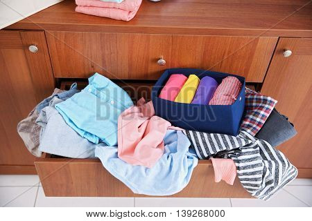 Pile of clothes in wooden drawer