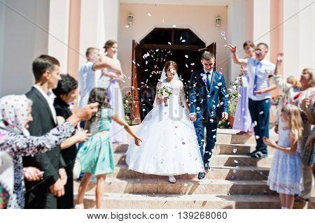 Guests Sprinkled  Rose Petals  For Newlywed After Church Registration