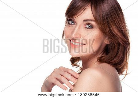 beautiful young redhead woman with freckles and blue eyes portrait isolated on white