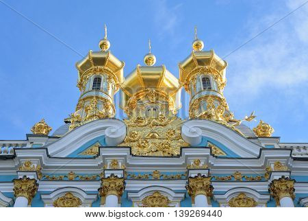 Golden cupolas of Catherine Palace church on the sky background suburb of St.Petersburg Russia.