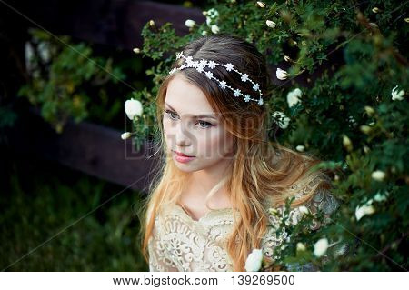 Close-up portrait of beautiful young girl with long blonde hair. Gentle and bright