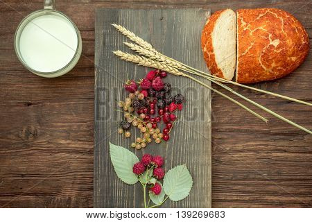 Bread Wild Berries And Cup Of Milk