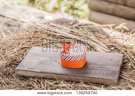 Red Heart Box On Wooden Board