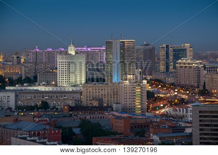 Russian Federation government building and residential buildings on new Arbat street at night in Moscow, Russia