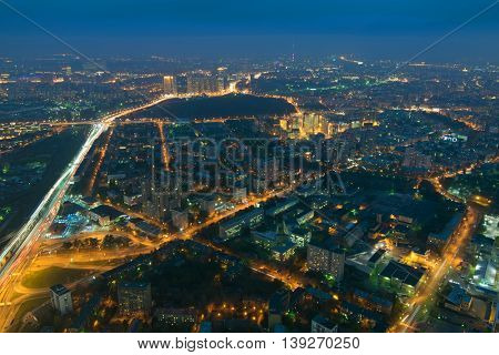 Highways, tall buildings in sleeping area at night in Moscow, Russia