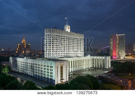 Russian Federation government building with flag at night in Moscow, Russia