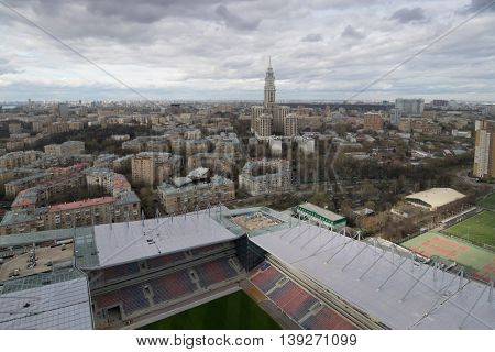 Part of stadium and panoramic view of city at cloudy day in Moscow