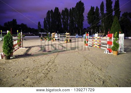 Show jumping hurdles on the race course at evening