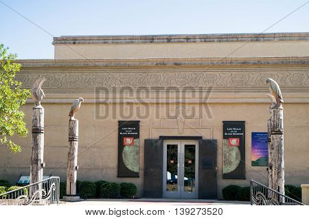 MOUNDVILLE, ALABAMA-OCT 18, 2015: Jones Archaeological Museum entrance guarded by carved wooden eagles at Moundville, Alabama