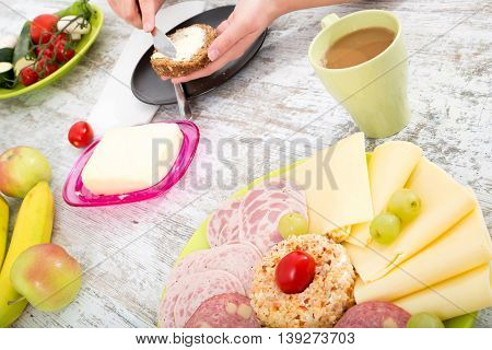 A woman having a breakfast at a table.