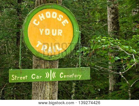SKAGWAY, ALASKA - AUG 2012 : CHOOSE YOUR TRAIL sign in Skagway, Alaska at Gold Rush Cemetery - Hiking trail options of Street Car route or Cemetery route