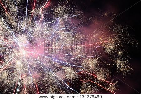 Creating light patterns at night with fireworks