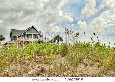 A Beach house sitting a top the dunes at Edisto Beach along the eastern coast of South Carolina.