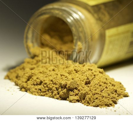 cumin cooking seasoning in a pile coming out from the jar