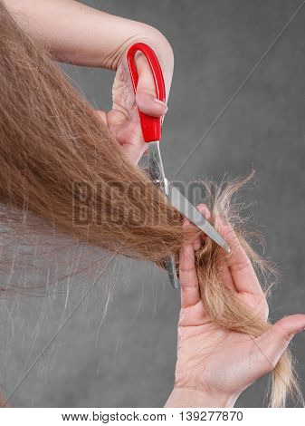 Blonde Woman Cutting Her Hair.