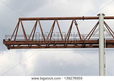 type of bearing metal structures of gantry crane against the blue sky