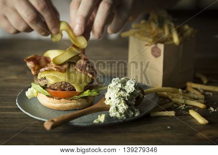 Cook brew broccoli bacon cheese burger in restaurant