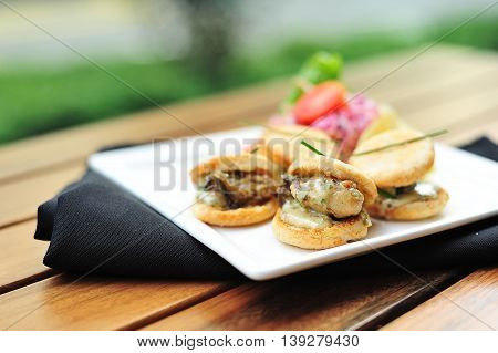 Virginia style Oyster Biscuits on white plate on the table