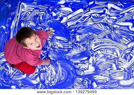Laughing Boy Splashing Hands In Large Painting
