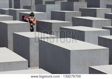 Traveler At Holocaust Memorial / Jewish Memorial In Berlin