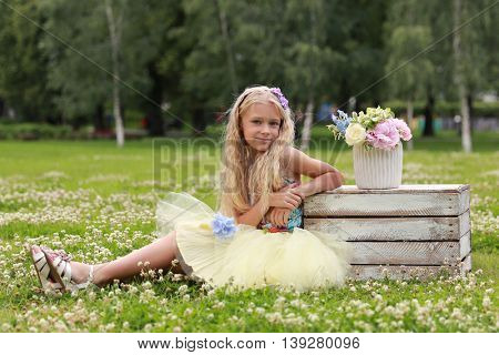 cute girl with flowers in park