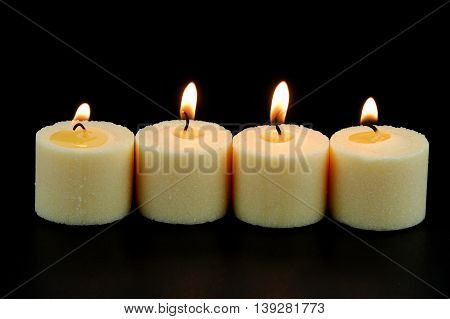 candle, flame, fire of white candles in a row on black background