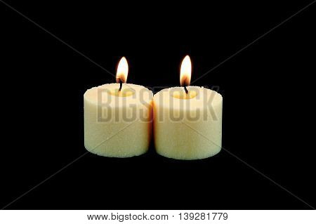 candle flame fire of white candles in a row on black background