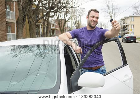 A Young owner man with his car