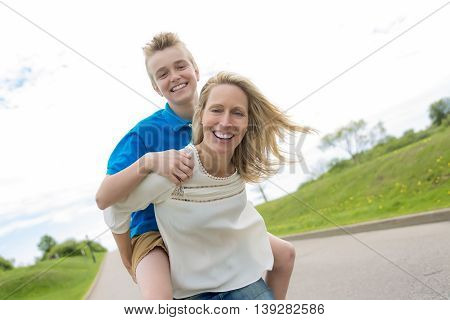 A happy family mother and herson spending time outdoor on a summer day