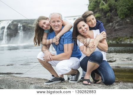 A Cheerful family in waterfall area portrait