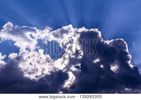 Sunbeam through the haze on blue sky, cloud with sunlight