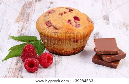 Fresh Baked Muffins With Raspberries And Chocolate On Wooden Background, Delicious Dessert
