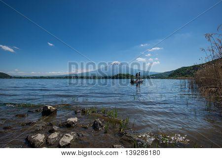 Mountain Fuji And Lake Kawaguchiko With Tourist On The Boat
